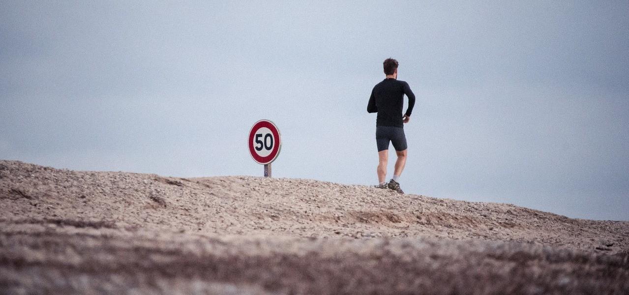man jogging along a beach